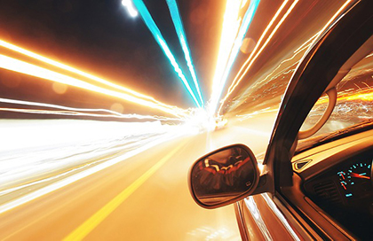 fast car on luminous highway