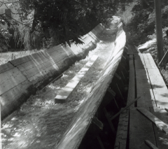 1960's era wooden logging flume with water running in it