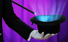 magician holding a magic top hat and wand